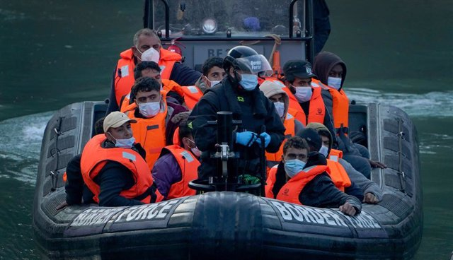 06 September 2021, United Kingdom, Dover: A group of people thought to be migrants are brought into Dover by Border Force officers, following a small boat incident in the English Channel. Photo: Gareth Fuller/PA Wire/dpa