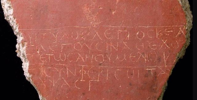 El poema conservado en un grafito de una habitación del piso superior en Cartagena España (siglo II al III d.C.).