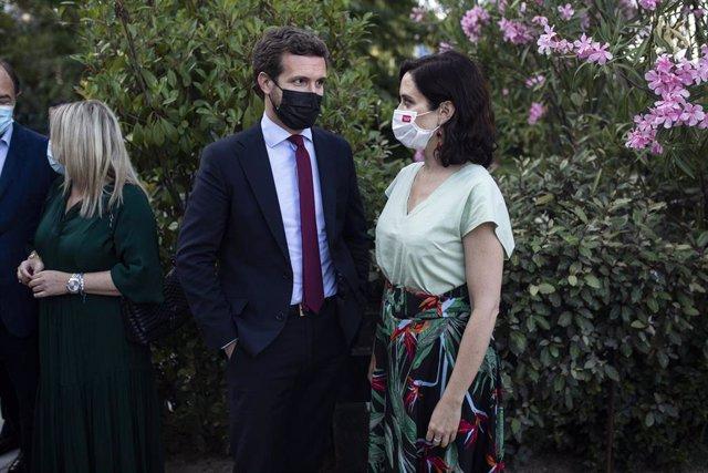 Archivo - El líder del PP, Pablo Casado y la presidenta de la Comunidad de Madrid, Isabel Díaz Ayuso,
