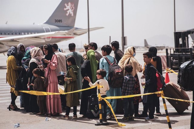 FILED - 18 August 2021, Afghanistan, Kabul: Afghan civilians wait to board an aircraft during the evacuation process at Hamid Karzai International Airport.  The evacuation is taking place due to the tense situation in Afghanistan after the takeover of the