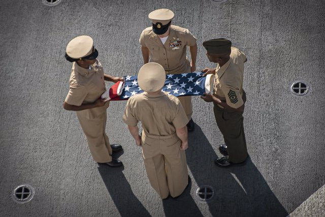 11 September 2021, US, New York: Marines fold an American flag during a commemoration ceremony for the 20th anniversary of the 9/11 terrorist attacks on the World Trade Center. Photo: Sgt. Alexis Flores/U.S. Marines/Planet Pix via ZUMA Press Wire/dpa