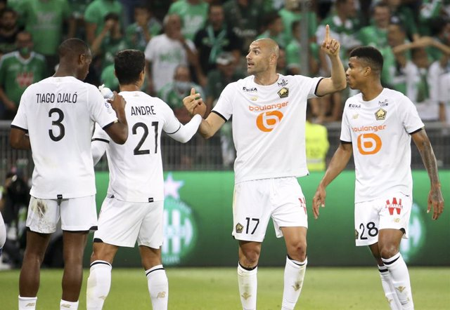 Burak Yilmaz of Lille celebrates his goal with Benjamin Andre and Reinildo Mandava during the French championship Ligue 1 football match between AS Saint-Etienne (ASSE) and Lille OSC (LOSC) on August 21, 2021 at Stade Geoffroy-Guichard in Saint-Etienne, F