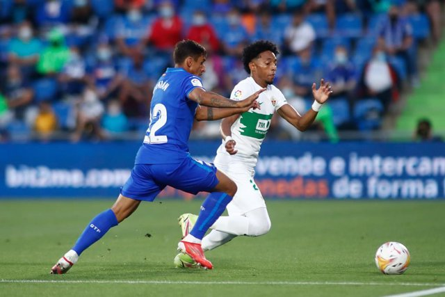 Johan Mojica of Elche and Damian Suarez of Getafe in action during the spanish league, La Liga Santander, football match played between Getafe CF and Elche CF at Coliseo Alfonso Perez stadium on September 13, 2021, in Getafe, Madrid, Spain.