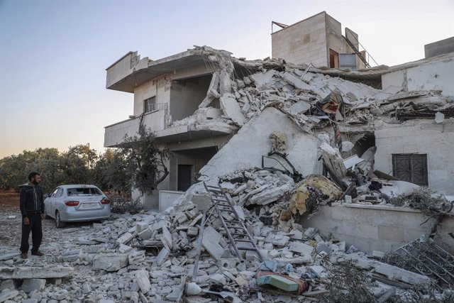 08 September 2021, Syria, Idlib: A man inspects the rubble of a damaged house in Idlib after it was targeted by artillery shells. According to a war monitor, at least four civilians were killed in the attacked, allegedly carried out by forces of the Syria