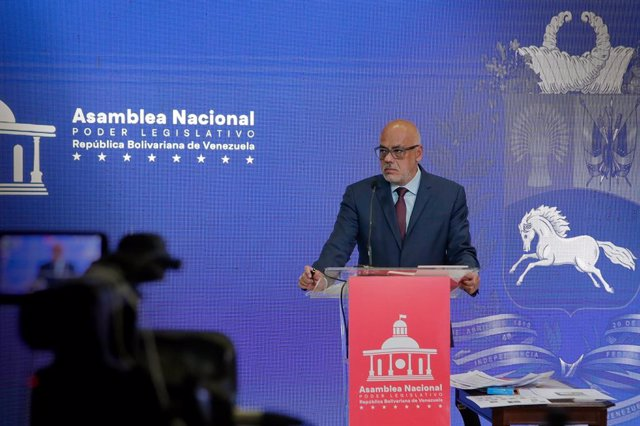 Archivo - 13 July 2021, Venezuela, Caracas: The President of the National Assembly of Venezuela, Jorge Rodriguez speaks during a press conference to comment on a supposed link between the Colombian government and the assassination of President Moise in Ha
