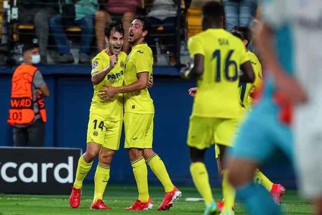 Manu Trigueros of Villarreal celebrates a goal with teammates during the UEFA Champions League, Group F, football match played between Villarreal CF and Atalanta BC at the Ceramica Stadium on September 14, 2021, in Villarreal, Spain.