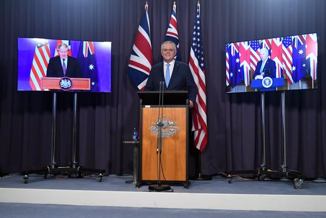 Britain's Prime Minister Boris Johnson, Australia's Prime Minister Scott Morrison and US President Joe Biden at a joint press conference via AVL from The Blue Room at Parliament House in Canberra, Thursday, September 16, 2021. (AAP Image/Mick Tsikas) NO A
