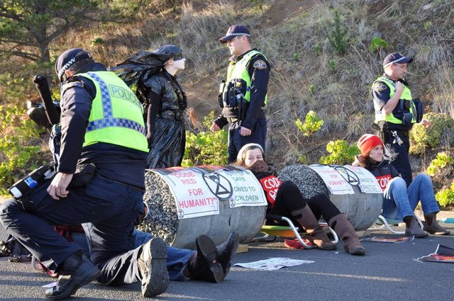 A supplied image shows protesters blockading a fuel terminal in Hobart, Thursday, August 19, 2021. Protesters across Australia have taken to blocking fuel terminals in response to the latest report by the Intergovernmental Panel on Climate Change, detaili