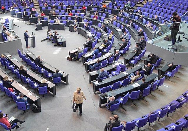 07 September 2021, Berlin: German Chancellor Angela Merkel (C) leaves after attending a plenary session at the German Bundestag. Photo: Michael Kappeler/dpa