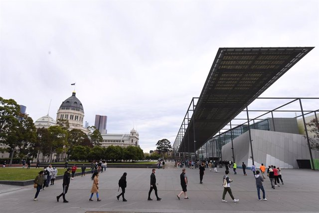"""People are seen waiting in line at the Melbourne Museum Covid19 vaccination clinic in Melbourne, Friday, September 17, 2021. Melburnians will soon be able to gather in small groups outdoors as part of a """"modest"""" easing of COVID-19 restrictions to mark Vic"""