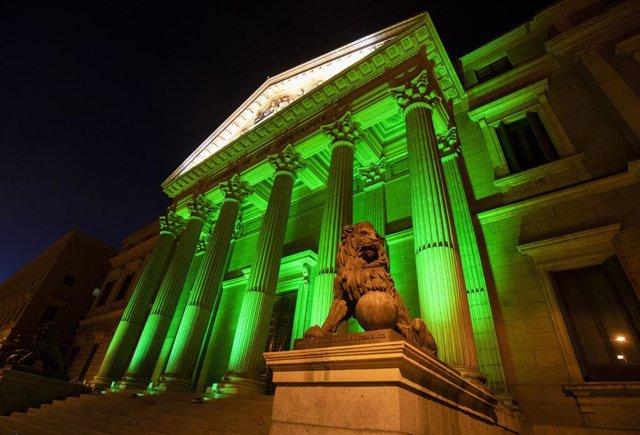 Archivo - El Congreso de los Diputados se ilumina de verde por el Día Mundial del Farmacéutico.