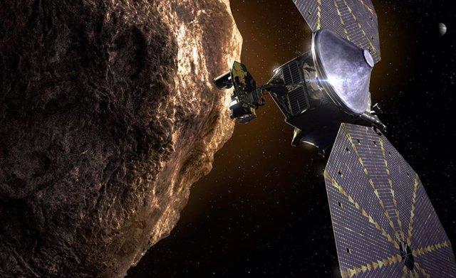 Ilustración de la nave Lucy junto a un asteroide troyano