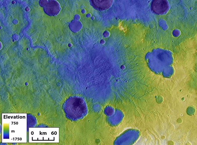 Los restos de un antiguo lago de cráter en Marte rodeado por otros cráteres más pequeños. El gran cañón de salida en la parte superior izquierda se formó durante un evento de ruptura del cráter.