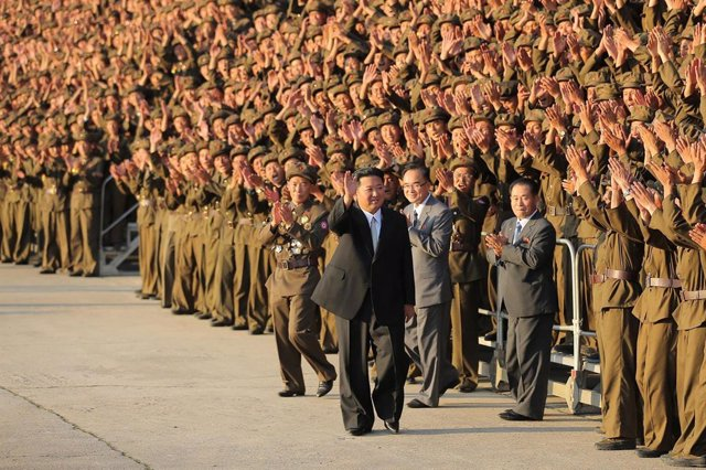 HANDOUT - 09 September 2021, North Korea, Pyongyang: A picture provided by the North Korean state news agency (KCNA) on 10 September 2021, shows North Korean leader Kim Jong-un waveing to participants as they line up for a group photo during the military