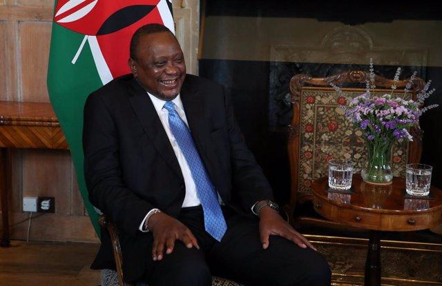 Archivo - 28 July 2021, United Kingdom, Buckinghamshire: Kenyan President Uhuru Kenyatta reacts during his meeting with UK Prime Minister Boris Johnson (not pictured) at Chequers. Photo: Peter Cziborra/PA Wire/dpa