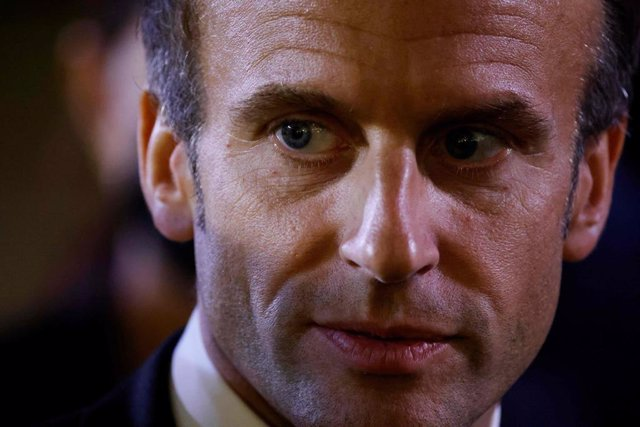 30 September 2021, France, Paris: French President Emmanuel Macron speaks to journalists upon his arrival at the Elysee Palace in Paris, where he hosted a dinner as part of the closing event of the Africa2020 season, which showcased the views of civil soc
