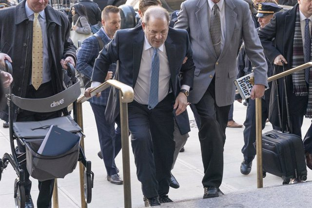 Archivo - 24 February 2020, US, New York: American former film producer Harvey Weinstein arrives for the opening day of his trial at state supreme court in New York. A jury found Weinstein guilty on two of the five sexual assault charges he faced at his t
