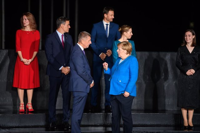 05 October 2021, Slovenia, Kranj: German Chancellor Angela Merkel (R) speaks with Prime Minister of the Czech Republic Andrej Babis  during a group photo at the EU-Western Balkans summit in Brdo Castle. Photo: Nebojsa Tejic/STA/dpa