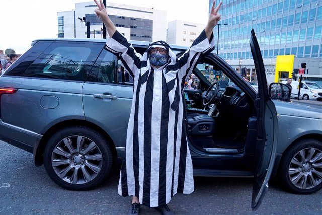 07 October 2021, United Kingdom, Newcastle: A Newcastle United fan celebrates at St James' Park following the announcement that The Saudi-led takeover of Newcastle has been approved. Photo: Owen Humphreys/PA Wire/dpa