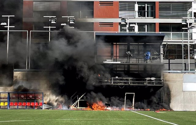 08 October 2021, Andorra, Andorra la Vella: A fire breaks out at Estadi Nacional after the television gantry at the side of the 3300-seater stadium was engulfed in flames three hours after England had trained ahead of Saturday's FIFA 2022 World Cup Europe