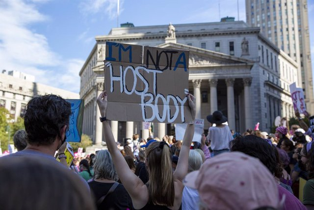 02 October 2021, US, New York: A woman holds a placard during a march through lower Manhattan as part of a nationwide protests against the new abortion law that has come into force in Texas. The law has banned abortions from the sixth week of pregnancy. P