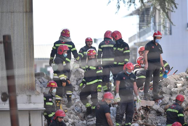 (211008) -- BATUMI, Oct. 8, 2021 (Xinhua) -- Rescuers work on the ruins of the collapsed building in Batumi, Georgia, Oct. 8, 2021. A multi-block residential building collapsed on Friday in Georgia's western coastal city of Batumi, leaving several people