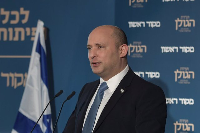 HANDOUT - 11 October 2021, ---, Golan Heights: Israeli Prime minister Naftali Bennett speaks during a conference held by Makor Rishon newspaper on Golan Heights Economic and Regional Development, in the Israel-annexed Golan Heights. Photo: Koby Gideon/GPO