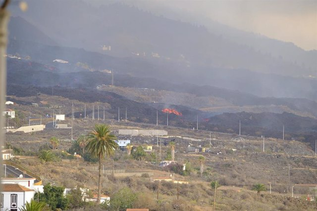 Lava from the Cumbre Vieja volcano reaches a cement factory on October 11, 2021, in La Palma, Canary Islands (Spain).  The stream located south of the cone of the volcano 'Cumbre Vieja', on the island of La Palma, located next to the main stream, is the qu