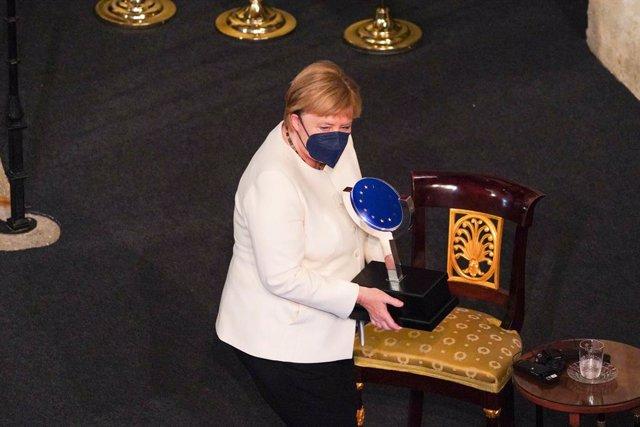 La canciller de la República Federal Alemana, Angela Merkel, recibe el 'Premio Europeo Carlos V' en su XIV edición, en el Real Monasterio de Yuste, a 14 de octubre de 2021, en Cuacos de Yuste, Cáceres, Extremadura, (España). Entregado por la Fundación Aca