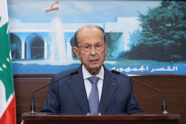 HANDOUT - 14 October 2021, Lebanon, Baabda: Lebanese President Michel Aoun gives a televised address from the Presidential Palace in Baabda. At least six people were killed and 32 others were injured in Beirut today in gunfire and clashes at a protest aga